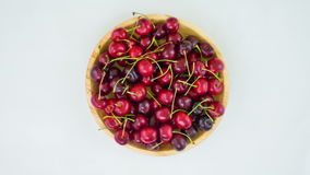 Fresh cherries on wooden plate, stop motion animation stock footage