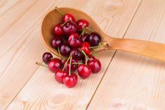 Fresh cherries in wooden spoon. Royalty Free Stock Photography