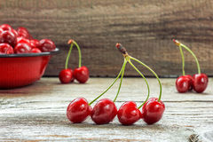 Fresh cherries. On wooden table Royalty Free Stock Images