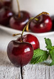 Fresh cherries on wooden table closeup royalty free stock images