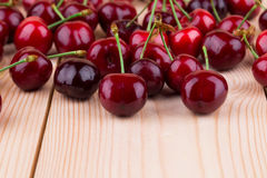 Fresh cherries on wooden table in the closeup. Royalty Free Stock Photo