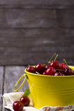 Fresh cherries on wooden table Royalty Free Stock Photography