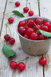 Fresh cherries on wooden table Stock Photo