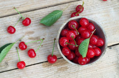 Fresh cherries on wooden table Stock Photos