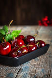 Fresh cherries on wooden table stock photography