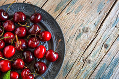 Fresh cherries on wooden table royalty free stock photo