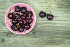 Fresh cherries on wooden table.Selective focus. Stock Images