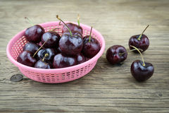 Fresh cherries on wooden table.Selective focus. Stock Photo