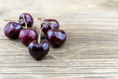 Fresh cherries on wooden table.Selective focus. Royalty Free Stock Photo