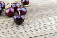 Fresh cherries on wooden table.Selective focus. Stock Image