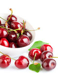 Fresh cherry berries with green leaf Stock Images