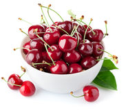 Fresh cherry berries with green leaf Royalty Free Stock Images