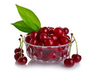 Fresh cherry berries with green leaf isolated Stock Photo