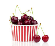 Fresh cherry berries in striped bucket Royalty Free Stock Photos