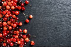 Fresh cherry on black slate. Copy space. Top view. High resolution product Royalty Free Stock Photo