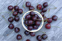 Fresh cherry in a bowl on a wooden background. Fresh cherry fruit on wooden background Stock Photos