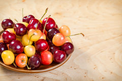 Fresh cherry in dish Stock Photos