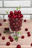 Fresh cherry fruits in a glass bowl  on a wooden table Royalty Free Stock Photography