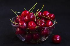 Fresh cherry in a glass plate stock photography