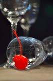 Fresh cherry on glass of wine Stock Photos