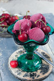 Fresh cherry ice-cream scoops in glass cone on the beach, summer Royalty Free Stock Images