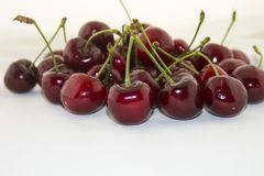 Fresh cherry isolated. Delicious and fresh, juicy and sweet summer fruit. Red cherries on a white background Royalty Free Stock Image