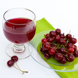 Fresh cherry juice. A cup of fresh cherry juice Royalty Free Stock Photo