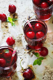 Fresh cherry juice Royalty Free Stock Images