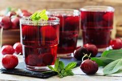 Fresh cherry juice Stock Images