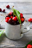 Fresh cherry in old rustic cup Stock Image