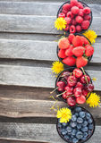 Fresh cherry, strawberry, blueberry and raspberry. On wooden table, copy space Royalty Free Stock Photography