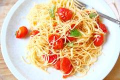 Fresh cherry tomato pasta with basil stock image