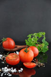 Fresh Cherry Tomato with Spice on Background Stock Photos