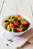 Fresh cherry tomatoes and avocado salad Royalty Free Stock Photos