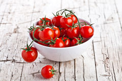 Fresh cherry tomatoes in a bowl Stock Photo
