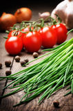 Fresh cherry tomatoes and chives Royalty Free Stock Photography