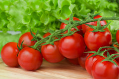 Fresh  cherry tomatoes closeup on the chopping board Royalty Free Stock Photos
