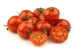 Fresh cherry tomatoes and a cut one Royalty Free Stock Photography