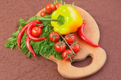 Fresh cherry tomatoes, dill and pepper Royalty Free Stock Image
