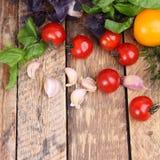 Fresh cherry tomatoes, garlic and basil Stock Photography