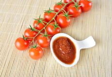Fresh cherry tomatoes and ketchup Stock Photos