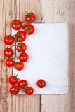 Fresh cherry tomatoes and piece of paper Royalty Free Stock Photography