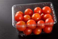 Fresh cherry tomatoes in plastic container Royalty Free Stock Photo