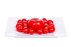 Fresh cherry tomatoes on plate isolated on white Stock Image