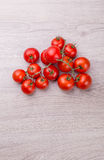 Fresh cherry tomatoes on rustic wooden background Stock Photos