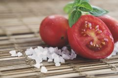 Fresh cherry tomatoes, sea salt and sweet basil. Organic ingredients. Healthy food stock images
