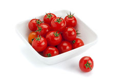 Fresh cherry tomatoes in square bowl Stock Image