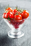 Fresh cherry tomatoes with stalks Stock Photo
