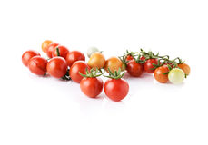 Fresh cherry tomatoes with stem isolated on white Royalty Free Stock Images