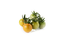 Fresh cherry tomatoes with stem isolated on white Stock Photo